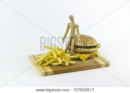 Wooden Doll Standing On A Hamburger