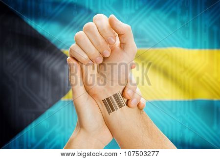 Barcode Id Number On Wrist And National Flag On Background - Bahamas