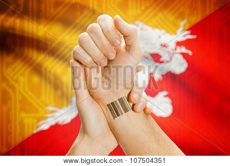 Barcode Id Number On Wrist And National Flag On Background - Bhutan