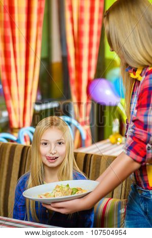 girl visitor imagines a tasty salad or delicious food awaits
