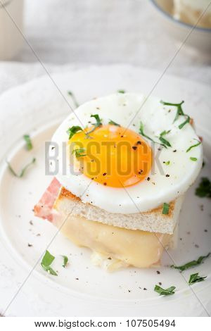 Croque madame, egg, ham, cheese sandwich. Traditional French cuisine.