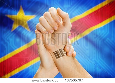 Barcode Id Number On Wrist And National Flag On Background - Congo-kinshasa