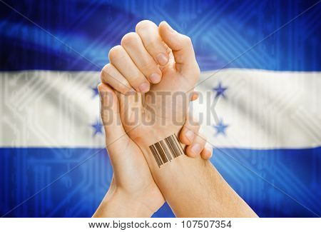 Barcode Id Number On Wrist And National Flag On Background - Honduras