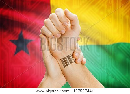Barcode Id Number On Wrist And National Flag On Background - Guinea-bissau