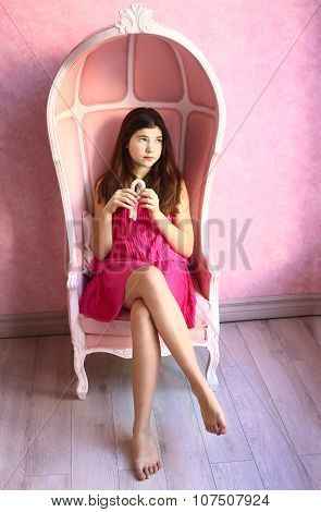 Girl  With Marshmallow Bar Sit In  Pink Armchair