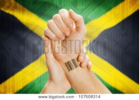 Barcode Id Number On Wrist And National Flag On Background - Jamaica