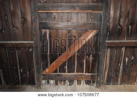 a weathered wooden barn door