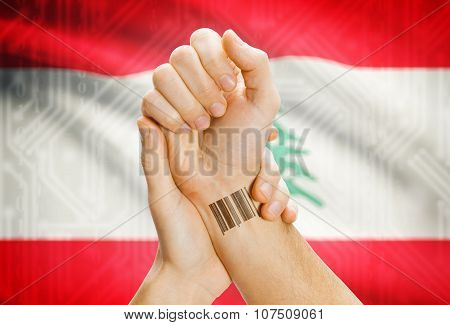 Barcode Id Number On Wrist And National Flag On Background - Lebanon