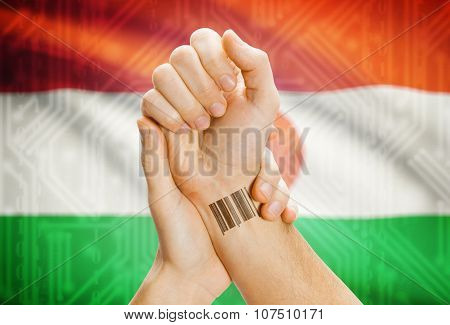 Barcode Id Number On Wrist And National Flag On Background - Niger