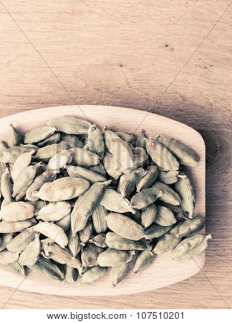 Green Cardamom Pods On Wooden Spoon