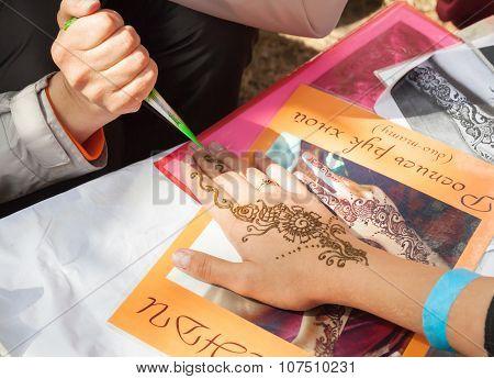 Mehndi Application On Woman Hand, Skin Decoration