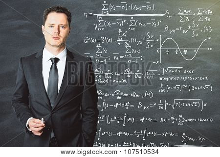 The Teacher Stands In Front Of The School Blackboard On Which Is Written Solution