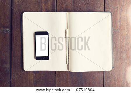 Blank Smartphone Screen On Blank Page Of Diary With Pen On Wooden Floor, Mock Up