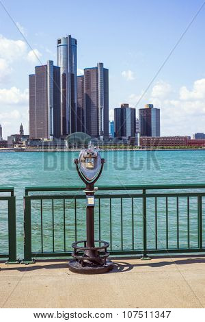 WINDSOR, ONTARIO - AUGUST 16, 2015: Sightseeing tourist binoculars overlooking downtown Detroit with the General Motors Renaissance Center in the background.