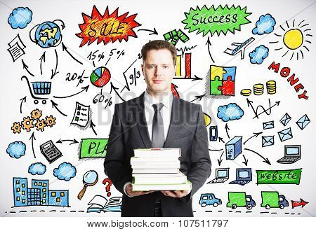 Businessman Holding A Pack Of Book With Business Strategy Concept On The Background