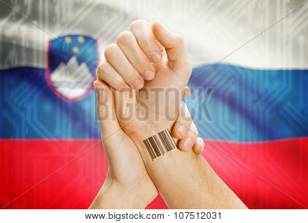 Barcode Id Number On Wrist And National Flag On Background - Slovenia