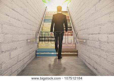 Businessman Walking On Suitcase Stairway Concept