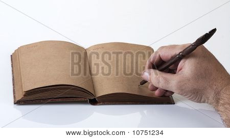 Male Writing In A Notebook, Close Up