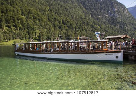 KOENIGSSEE, GERMANY - AUGUST 13, 2015: Pleasure boat at the landing stage of St. Bartholomew where the famous church is located