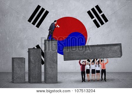 Entrepreneurs Make Graph With Flag Of South Korea