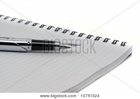 Rollerball Pen On Notepad