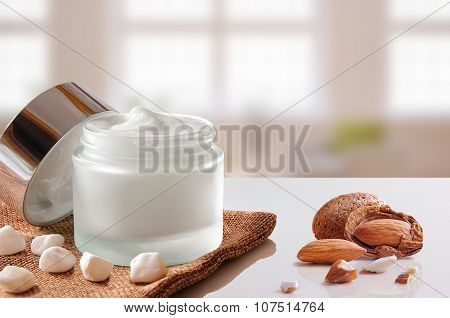 Almond Moisturizer Jar Open On Burlap Windows Background