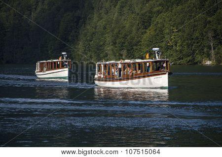 KOENIGSSEE, GERMANY - AUGUST 13, 2015: Electric pleasure boats operating on the Koenigssee lake and commute between Schoenau St. Bartholomew and Salet