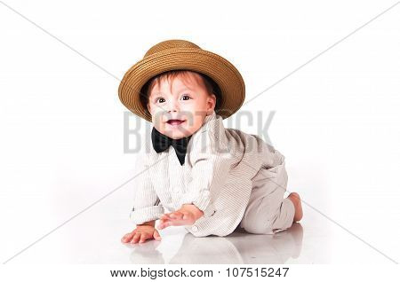 Funny Smiling Baby In In Suit, Retro Hat And A Bow-tie,  Crawling Over White Background