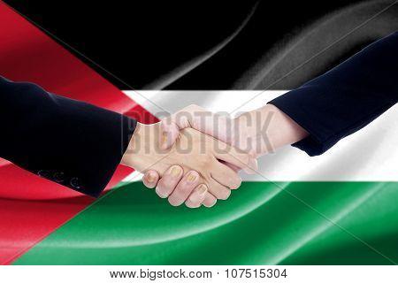 Handshake With Flag Of Palestine