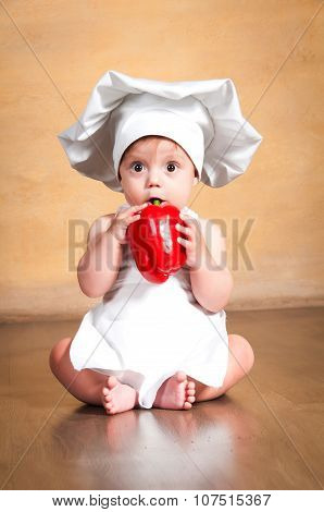 Vegetables Are Good For Health. Little Cook In A Chef's Hat Eating Fresh Red Paprika