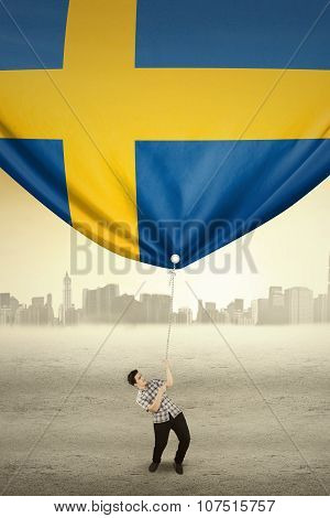 Handsome Person Drags Flag Of Sweden