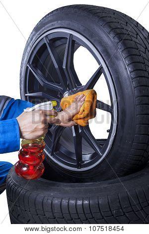 Mechanic Wash The Rim Of Tire