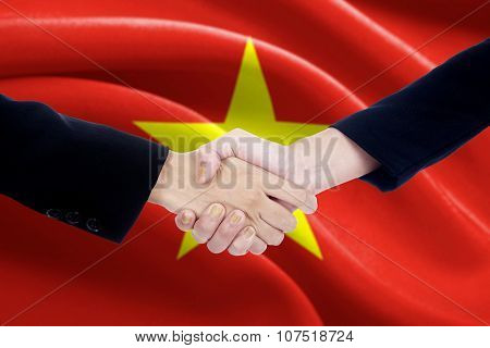 People Shaking Hands With Flag Of Vietnam