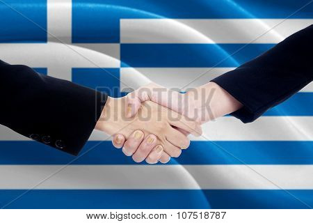 Politicians Shaking Hands With Flag Of Greece