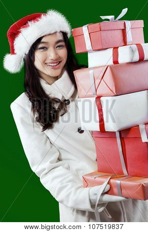 Sweet Girl Holding Christmas Presents
