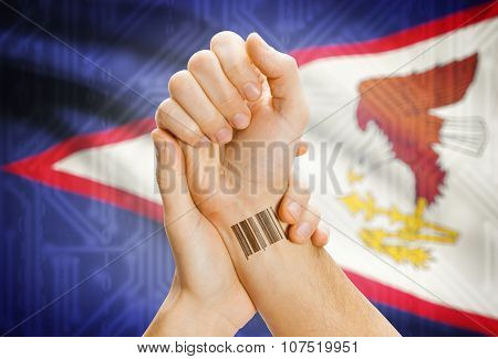Barcode Id Number On Wrist And National Flag On Background - Aruba
