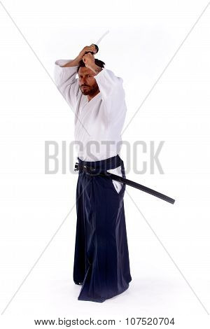 aikido master with sword above his head