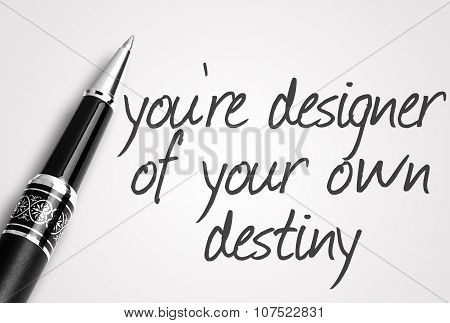 Pen Writes You're Designer Of Your Own Destiny On White Blank Paper