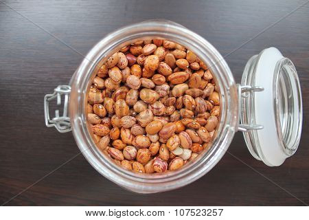 Dried red beans in a glass jar on the table