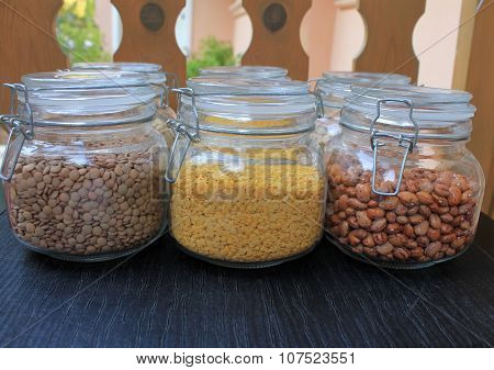 Grains and beans in glass jars