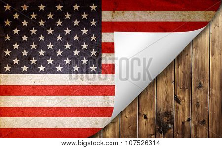 Grunge American flag turning page on wooden board