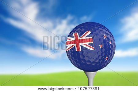 Golf ball with New Zealand flag colors sitting on a tee