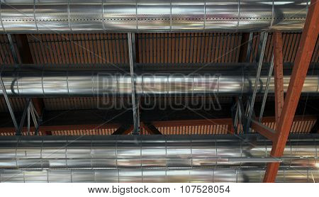 Great Pipes Of A Heating And Air-conditioning Under The Roof Of The Shed