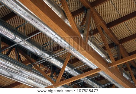 Pipes Of A Heating And Air-conditioning Under The Roof