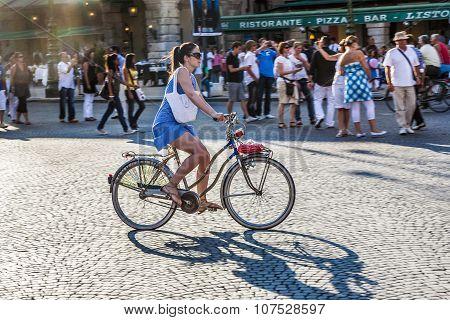 Woman Cycling At Piazza Bra In Verona