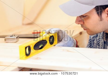 Carpenter looking at a bubble level