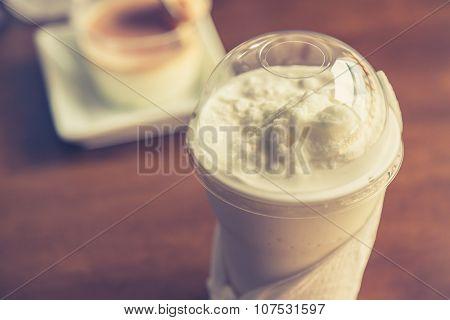 Fresh sweet coconut milk shake ( Filtered image processed vintage effect. )