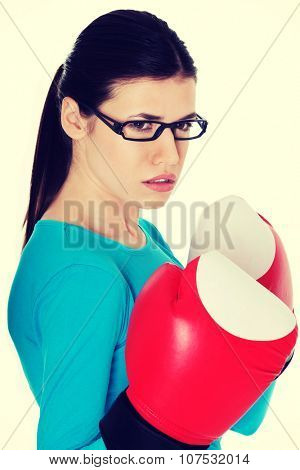 Portrait of a casual woman with boxing gloves