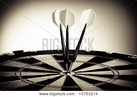 Perspective Photo Of Three Arrows On Darts Table