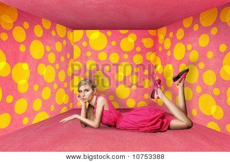 Surprised Blonde In Pink Dress